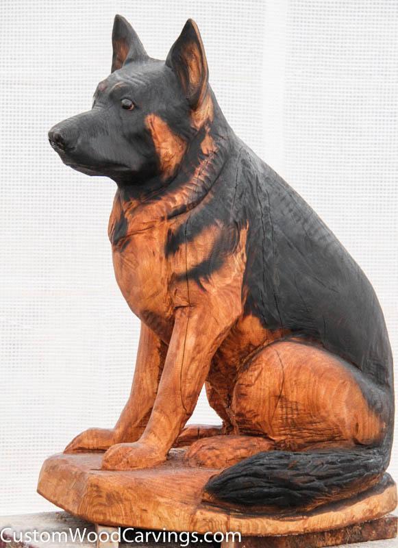 Life size dog carvings doberman and german shepherd