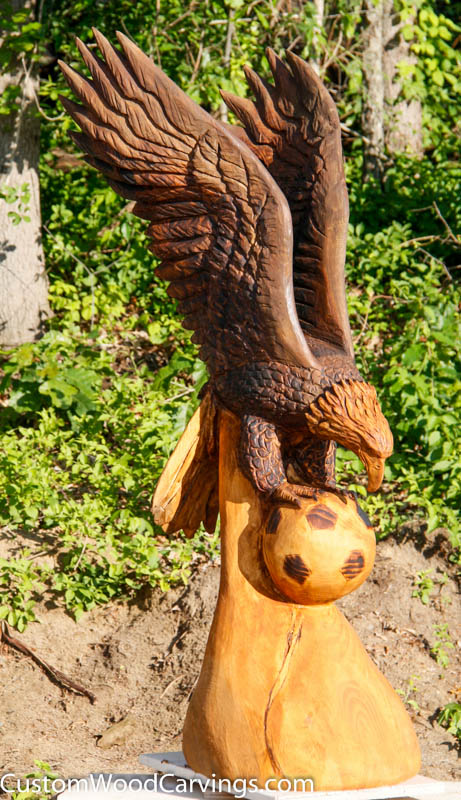 Ft soaring eagle with soccer ball custom sculpture