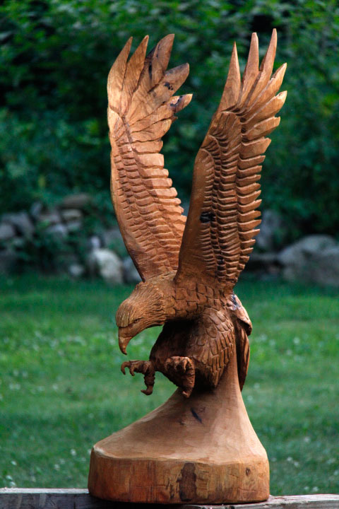 How to chainsaw carve a soaring eagle custom sculpture