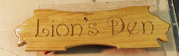 lions-den-wood-sign